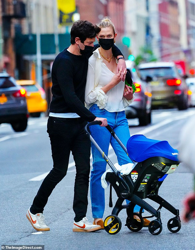 Just the Three of Us: The 28-year-old supermodel sported classic jeans and a blouse as she strolled with her family in Manhattan