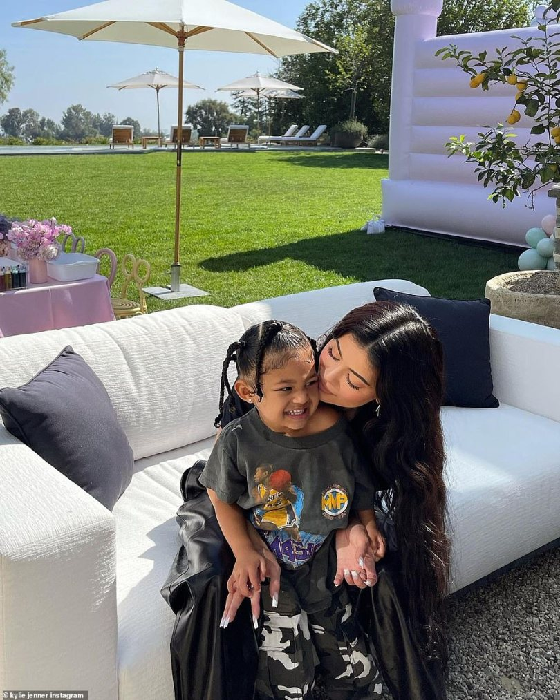 Happy:The Kylie Cosmetics founder also posted a series of snaps to her Instagram grid while lounging on a couch outside with Stormi