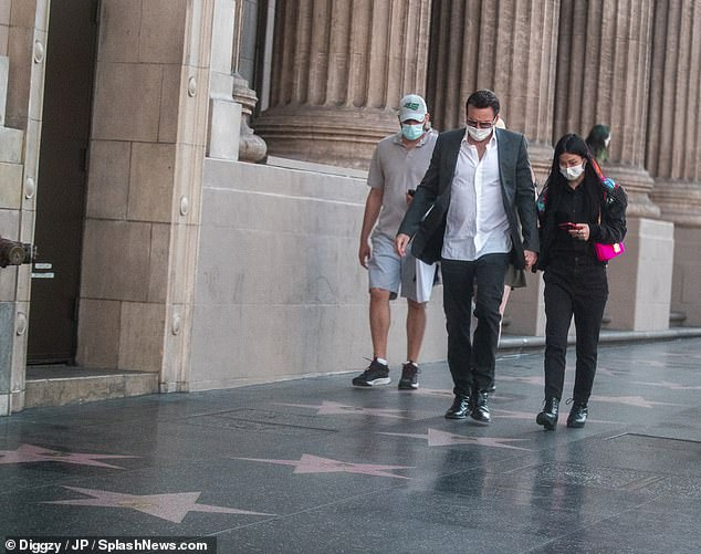 Busy day: The duo held hands as they made their way to his star