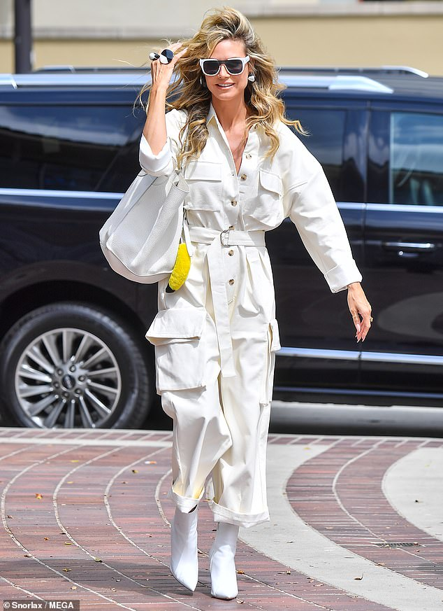 Making an entrance: America's Got Talent judge Heidi Klum turned heads in all white outfit as she arrives at production for the hit NBC show alongside fellow panelists Sofia Vergara and Howie Mandel