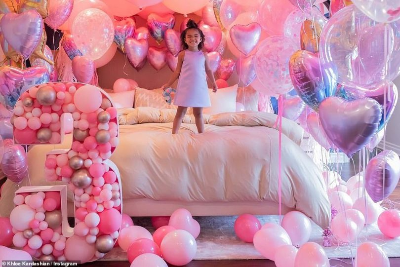 Amazing day: True beamed on her bed with a large balloon filled number 3 in front