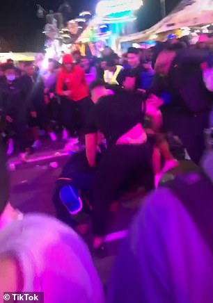 A group of at least 10 men were seen brawling in the middle of the footpath inside the showground
