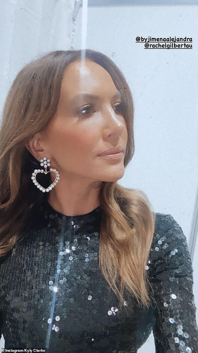 Cute: She also wore a cute pair of pearl heart earrings