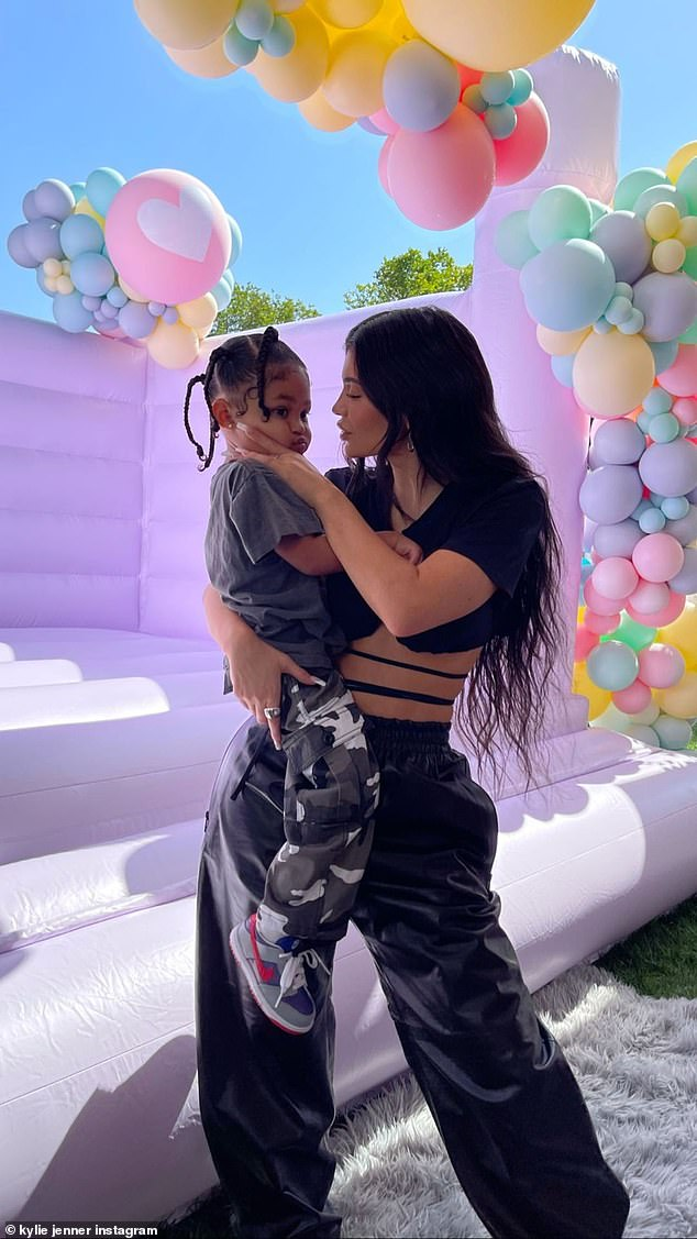Dress to impress: Kylie Jenner, 23, and fashionista daughter Stormi, three, turn heads in designer duds as they host Khloe Kardashian's celebration for True Thompson