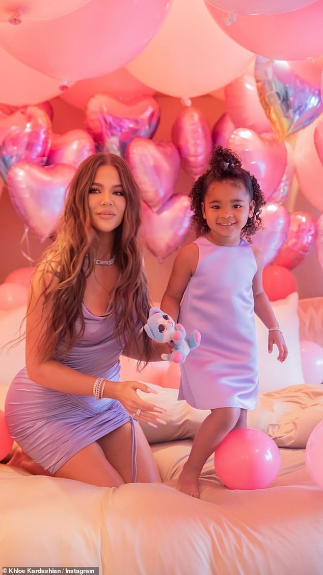 Over the top: Despite not hosting at her own home, Khloe splashed out on a decadent display of balloons that covered True's room and they wore matching shades of lilac