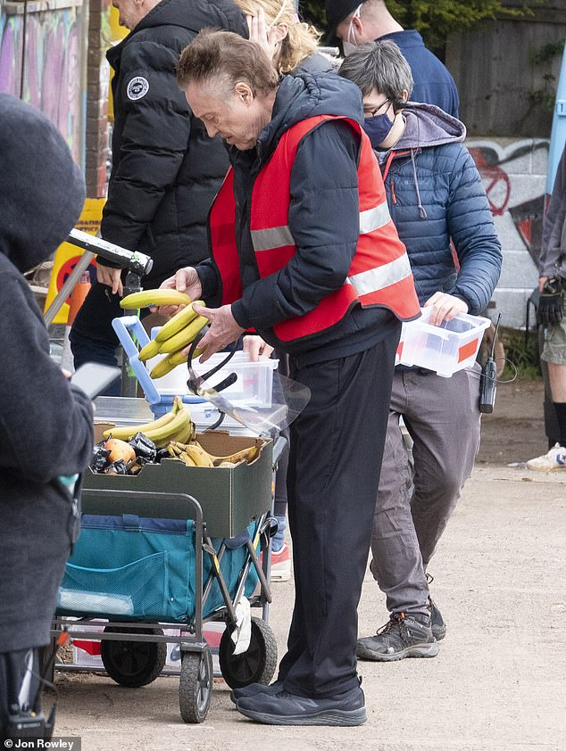 Feeling fruity: Walken grabbed a banana from a catering trolley as he waited for his next scene