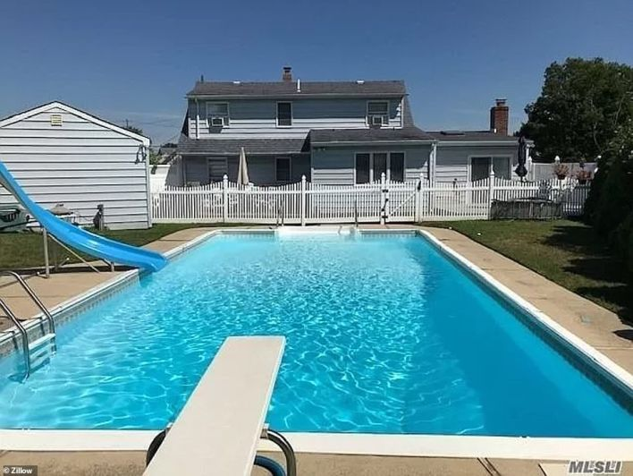 LINDENHURST, LONG ISLAND: This five bedroom home in Kramer Street was sold by Lucky to Live Here Realty for $500,000 at the end of March, more than $20,000 over its $479,900 asking price