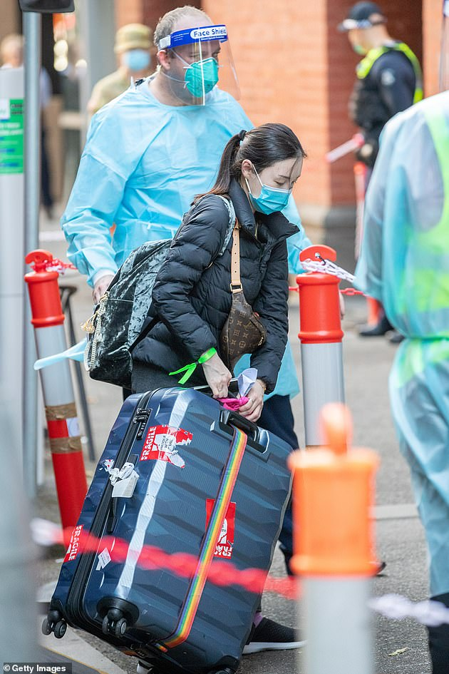 An international traveler carries his luggage to the Intercontinental Hotel on April 8 in Melbourne (pictured) - with severe restrictions preventing most Australians from traveling abroad