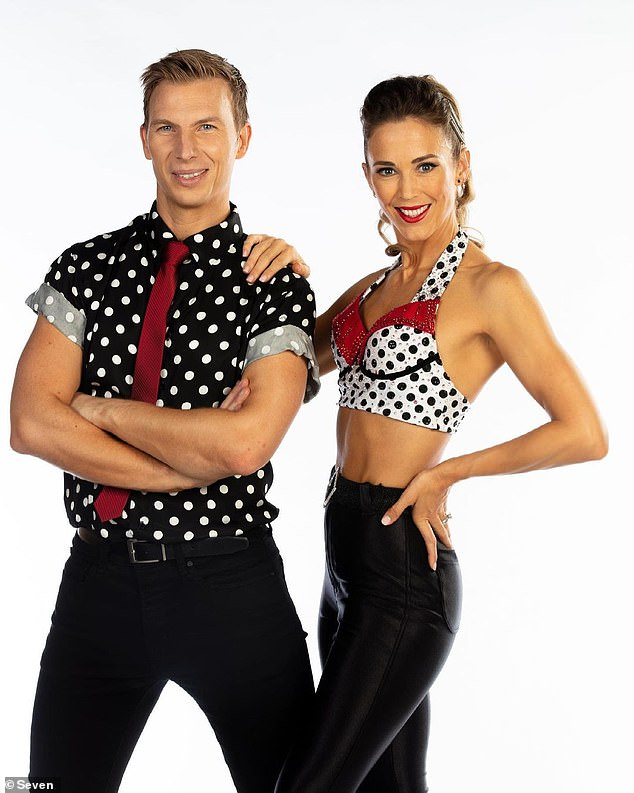 She's ripped! Bec Hewitt, 37, showed off her super toned abs and bulging biceps in a tiny crop top on Dancing With The Stars on Tuesday night as she did the jive with her dance partnerCraig Monley