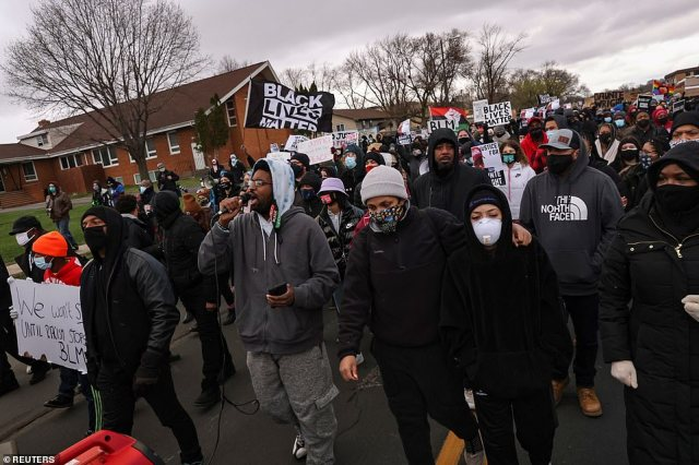 Protesters participate in a march Tuesday, days after Daunte Wright was shot and killed by a police officer, in Brooklyn Center