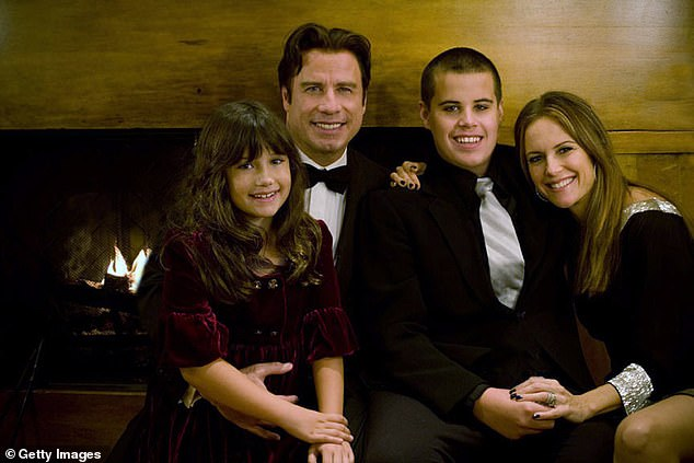 Tragedy: Jett died in January 2009 during a family trip to the Bahamas after he hit his head on a bathtub following suffering a seizure at their home on Grand Bahama Island; Travolta seen with daughter Ella, son Jett and wife Kelly Preston