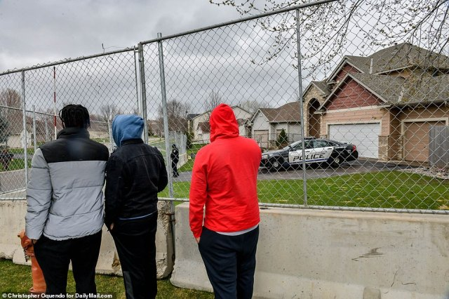 Barriers and metal fencing was put up around the home of Officer Kimberly Potterwho resigned from the force Tuesday
