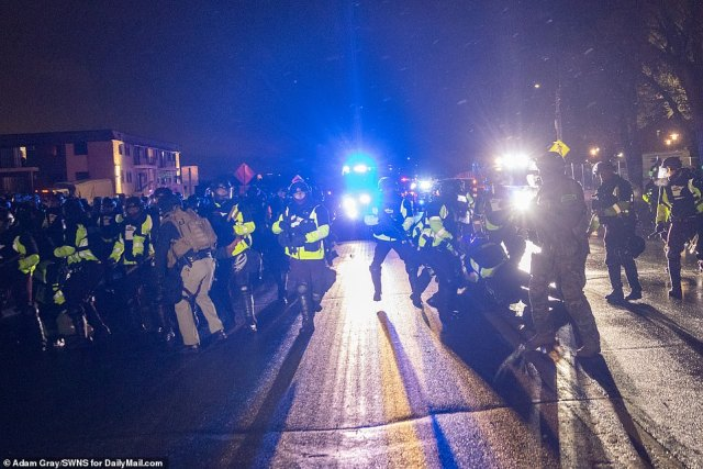 Police and protesters faced off once again after nightfall Tuesday. 'Whose street? Our street!' the crowd chanted.The unrest had continued after the Hennepin County medical examiner ruled Wright's death as a homicide and said the cause was a gunshot wound to the chest