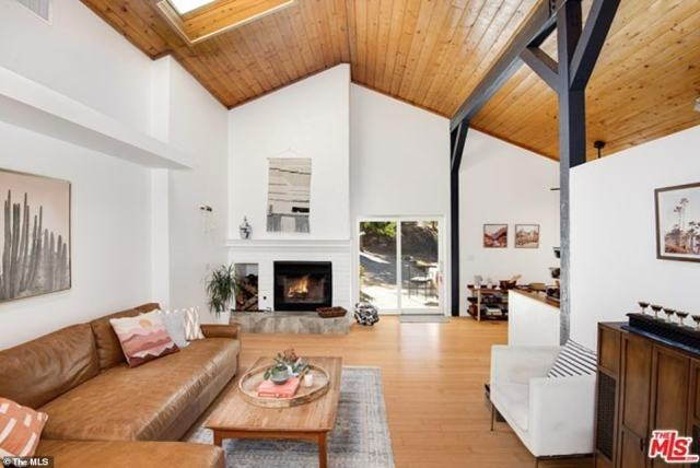 Cullors' new home has high ceilings and a sliding door leading out to the tree-filled yard