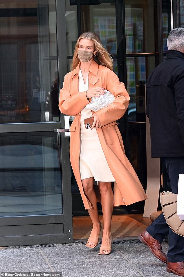 Leggy lady: Rosie braved the unreliable weather of the bare-legged season and donned a comfy but chic pair of block heels for her busy day