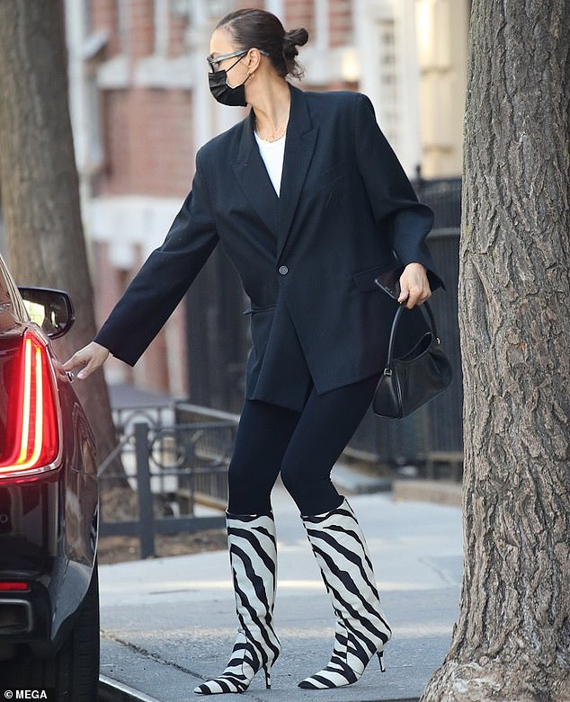 Catching a ride: Shayk was then seen hopping into a car to run the remainder of her errands without having to ruin her stunning new footwear