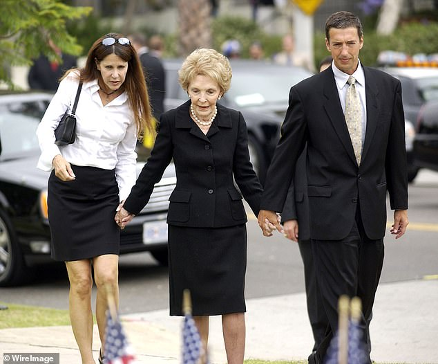 Nancy Reagan (center) with son Ron Reagan Jr. and daughter Patti Davis are pictured arriving at Gates Kingsley and Gates Moeller Murphy funeral home in Santa Monica after President Reagan's death in 2004