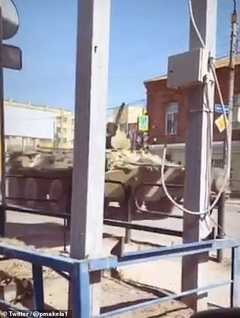 Yesterday footage emerged in Astrakhan, 350 miles from the border, showing Russian BTR 80 armoured personnel carriers daubed with broad white stripes on their way to railway stations.