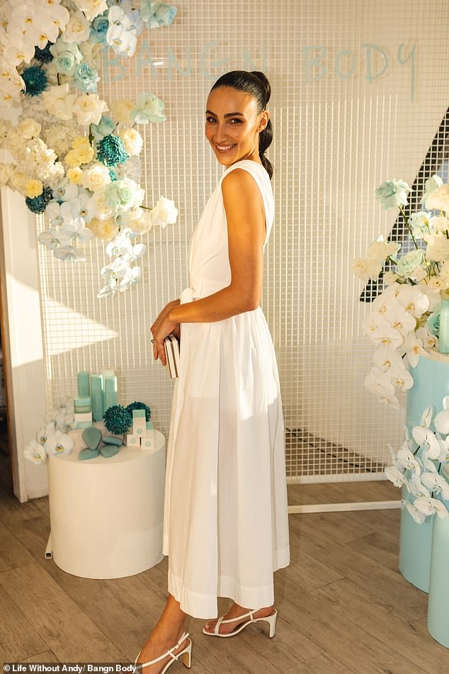A delight in white:Meanwhile, Tayla looked heavenly in an elegant white ankle-length dress teamed with strappy white sandal