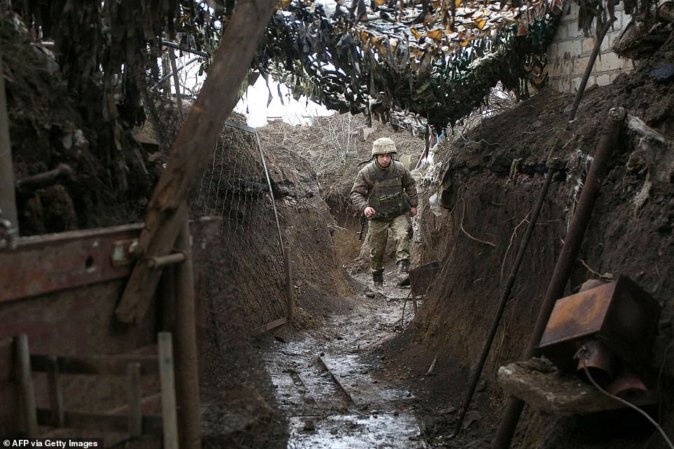 Ukrainian troops man trenches in the eastern Donbas region as the country's foreign minister warns Moscow it will bear 'very painful consequences' if it invades