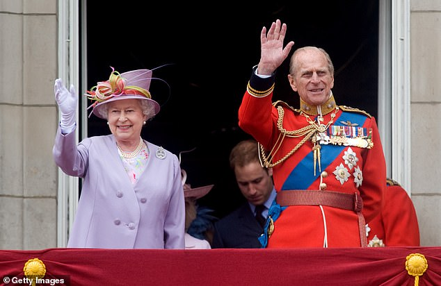 Queen Elizabeth II and Prince Philip, Duke of Edinburgh wave the balcony of Buckingham Palace in 2010