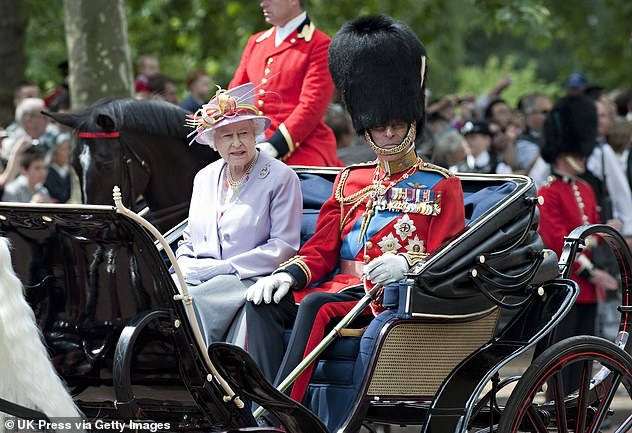 Prince Philip and the Queen are pictured in a horse-drawn carriage on the mall during Trooping the Color in 2010