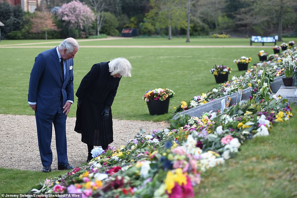 The flowers and condolence messages were moved from outside Buckingham Palace to nearby Marlborough House today
