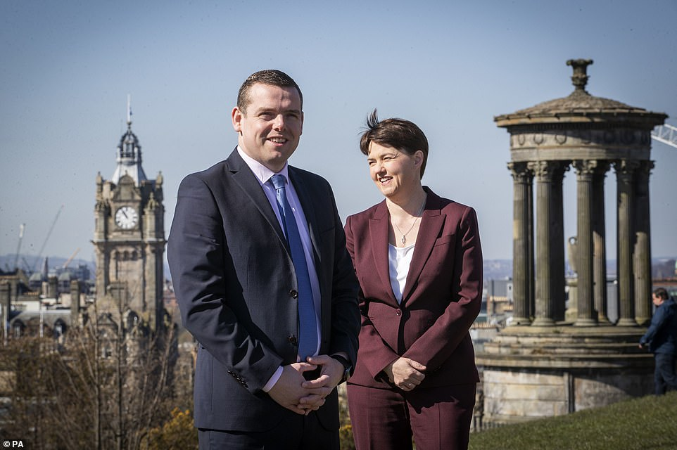 Scottish Tory leader Douglass Ross (pictured left, today in Edinburgh) said the SNP would be remembered for 'promises made, that have never been delivered'