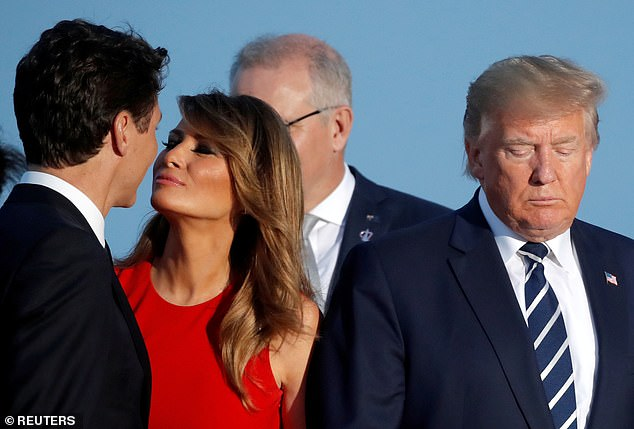 2019:First Lady Melania Trump kisses Canada's Prime Minister Justin Trudeau next to the U.S. President Donald Trump during the family photo with invited guests at the G7 summit in Biarritz, France. The famous photo was taken in August 2019, months before the pandemic