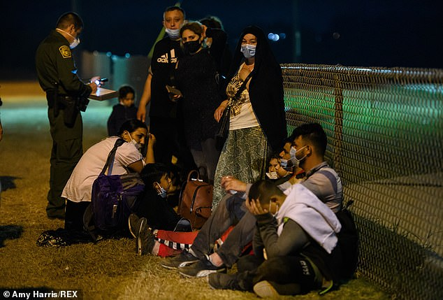 Thousands of migrants continue to arrive at the US-Mexico border. Here Romanian immigrants were taken into Border Patrol custody at the La Joya, Texas, border after crossing the Rio Grande River from Mexico on April 13