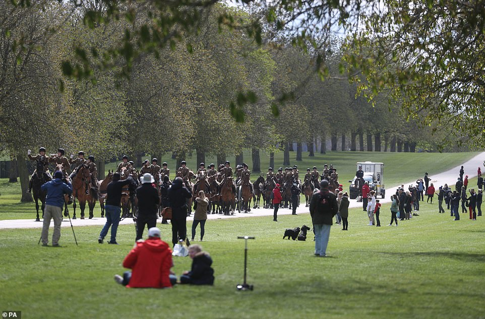 Scores of people, some sitting with picnic lunches, watched as the riders passed by in Windsor this afternoon