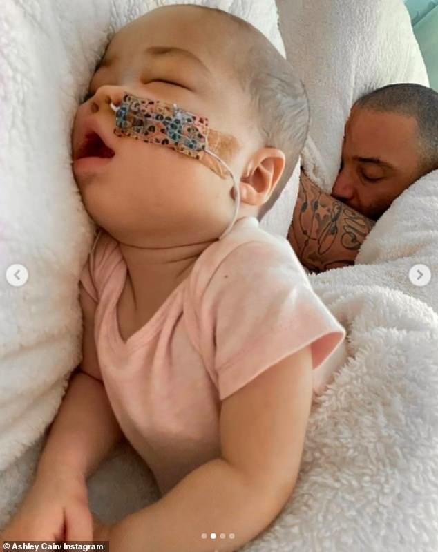 Cute: The former Ex On The Beach star, 30, took to Instagram on Friday to post adorable new snaps with his eight-month-old as she took a nap beside him