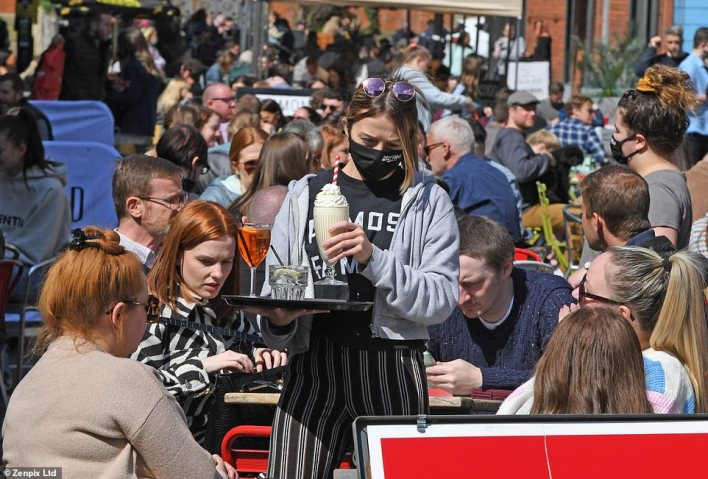 Crowds gather to eat in Manchester's Northern Quarter today as people make the most of being able to dine outside