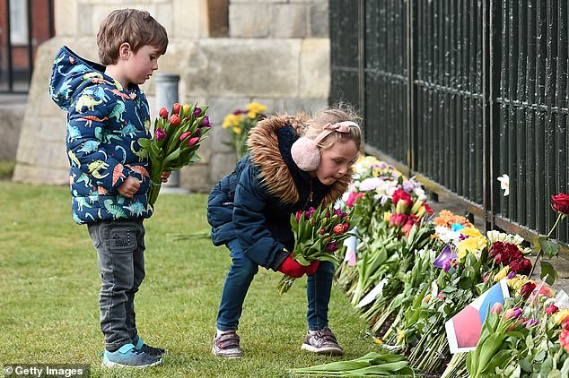 Children leave floral tribute to Prince Philip, Duke of Edinburgh, ahead of his funeral