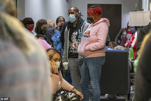 Family and friends wait for word of their loved ones who were at the FedEx Ground facility during a shooting in Indianapolis, Thursday night