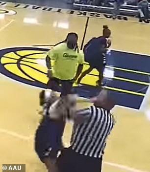 The girl tries to hit the referee, but he thwarts her attempt, sending her staggering backward