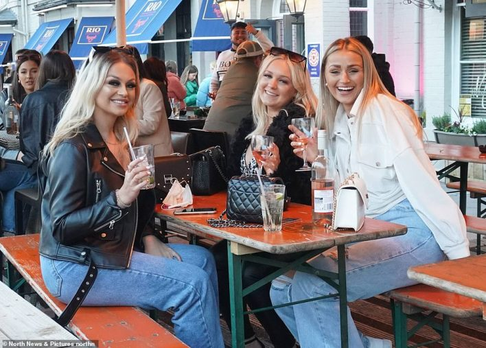 A group of girls enjoy some drinks in Newcastle this evening on the first Friday night out since restrictions were eased