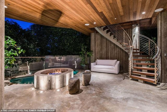 A great place to host the VIPs of Malibu: There is also a floor that is open air and has a fire pit along with a hot tub and plenty of room for outdoor furniture