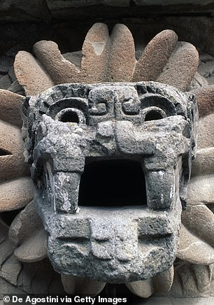 A relief feathered serpent on the facade of the Temple of Quetzalcoatl in the Citadel of Teotihuacan outside Mexico City