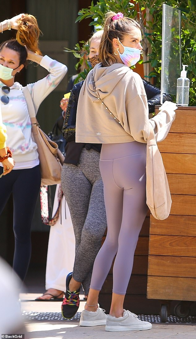 Fabulous figure: The former model wore yoga pants and a cropped sweatshirt on the fifth day of her 40th birthday celebration which began on her birth date on April 11.