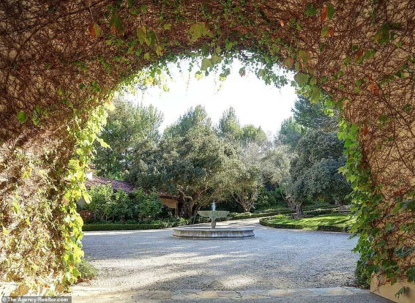 A place in the sun:The grounds also feature an apparently stucco archway covered in vines that opens onto a charmingly tranquil little courtyard with a fountain in the middle of it