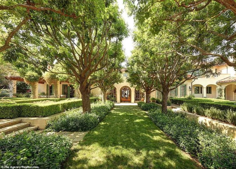 Gorgeous:Out in the gardens Dwayne and his family can stroll through a tree-lined grass pathway flanked by immaculately manicured hedgerows and raised platforms