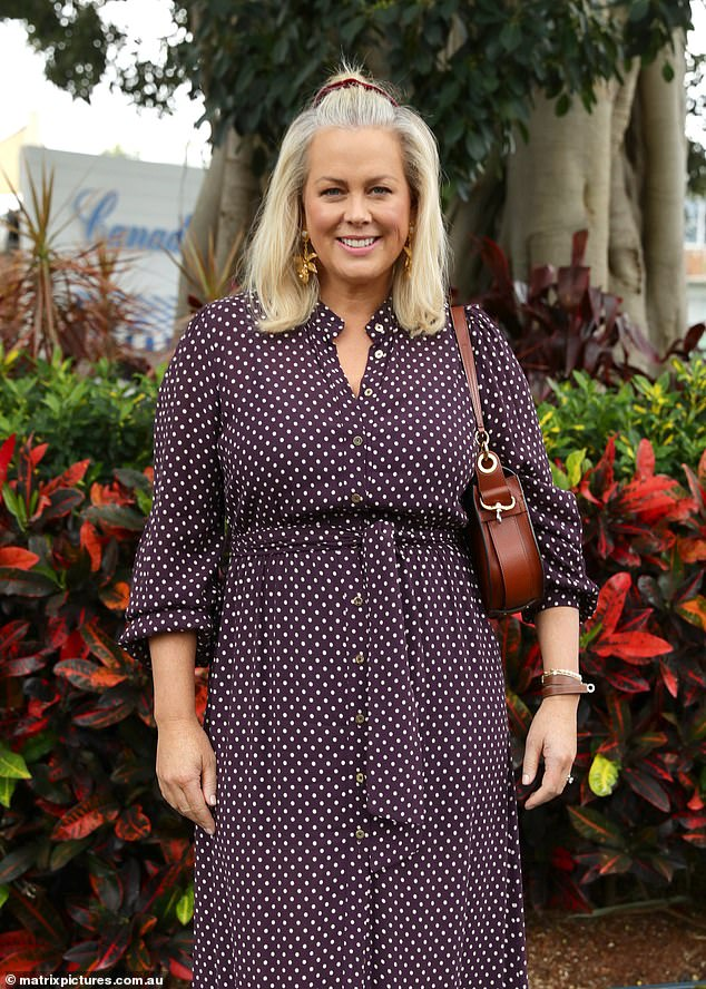 Pretty in polka dot: Samantha Armytage showed off her stylish ensemble at the race day event dressed in a purple polka dot midi dress