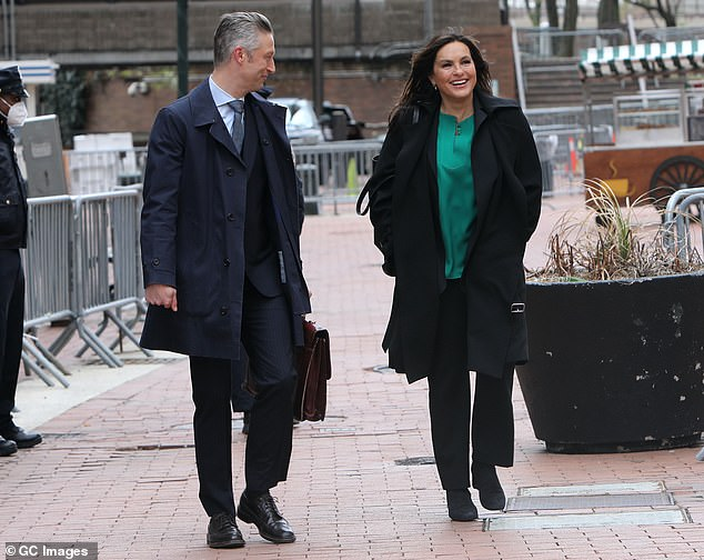 Interesting outfit: Hargitay contrasted her otherwise dark clothing choices with a green blouse