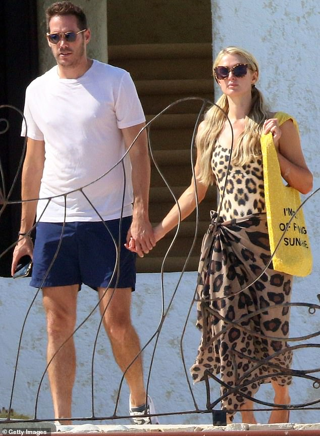 Hand in hand:Paris is currently engaged to dashing businessman Carter Reum, announcing the news the day before Valentine's Day this year; pictured last September in Cabo