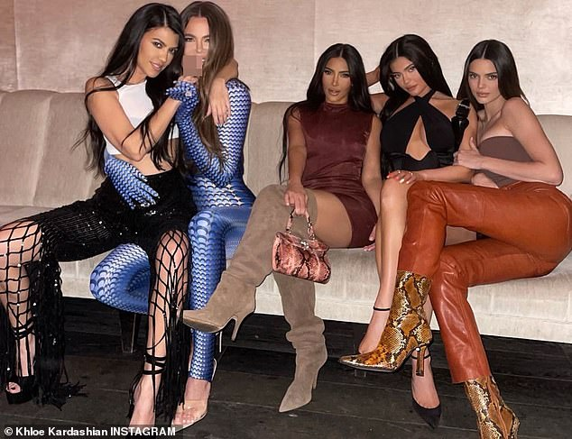Terrific:Khloe Kardashian, who also posted a sofa picture of all the sisters, was decked out in a skintight jumpsuit with a polka dot print reminiscent of the 1970s