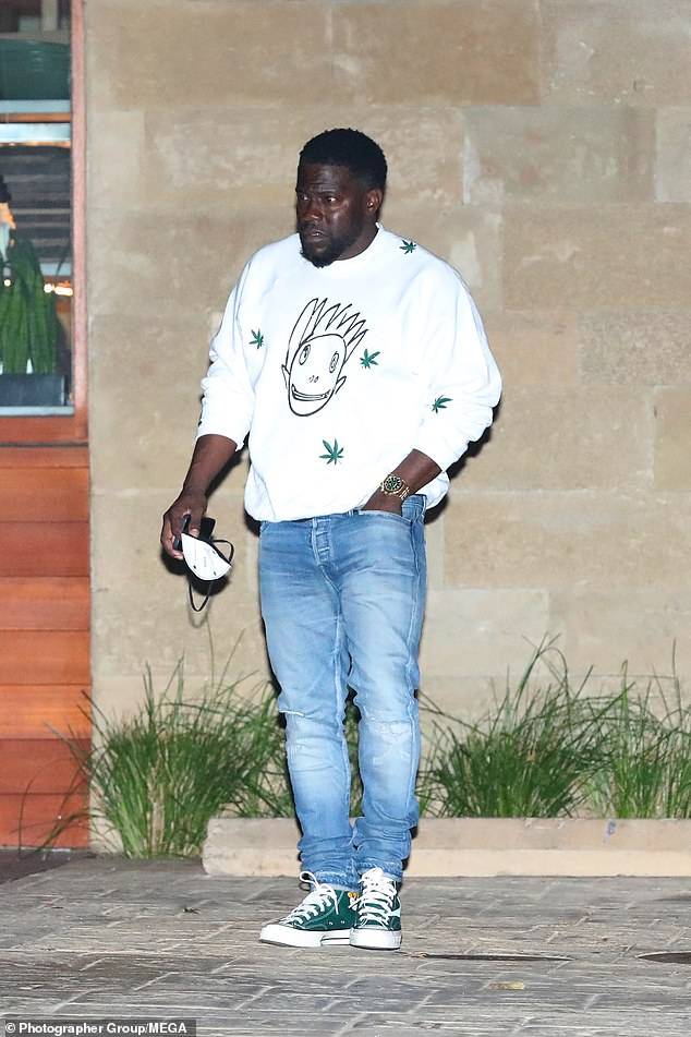 Stepping out:Kevin looked relaxed in light blue jeans and a white jumper and completed his low-key look with green trainers