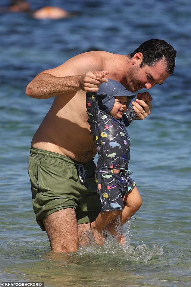 Have fun in the sun!  Peter Stefanovic welcomed his second son, Henry George, earlier this month.  On Friday, the Sky News presenter and his firstborn, Oscar, one, stepped out for a one-on-one bonding moment as they made their way to the beach in North Bondi, Sydney.  Both in the photo