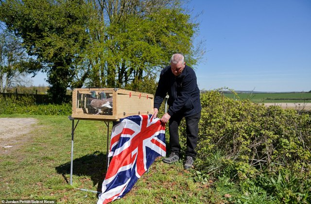 Jim Jolly of The Royal Pigeon Racing Association (RPRA) liberates his racing pigeons in memory of the Duke of Edinburgh on the day of his funeral