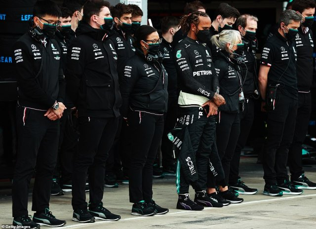 Lewis Hamilton of Great Britain and Mercedes GP and his team stand for a minutes silence in tribute of the late Duke of Edinburgh Prince Phillip